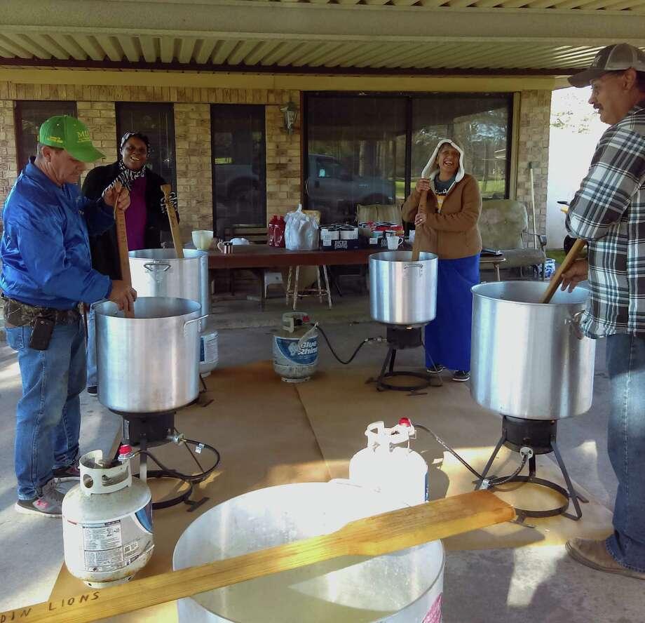Lions Wayne Stark, Bonita Davis, Linda Brandl and Daron Mettlen spent the morning hours stirring huge pots of chili. Photo: Submitted