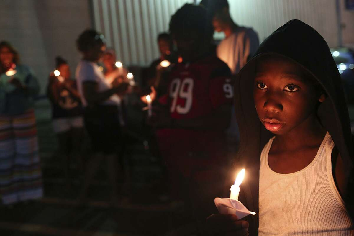 Nac'eir Bell, 11, joins friends, family and supporters of Marquise Jones during the vigil for the third anniversary of Jones' death outside Chacho's restaurant in San Antonio on Tuesday, Feb. 28, 2017.