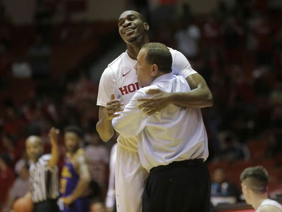 Houston Cougars forward Bertrand Nkali (13) gets a hug from Houston Cougars head coach Kevlin Sampson after being pulled out of the game in the final seconds against East Carolina Pirates basketball game in the last game at Hofheinz Pavilion on Sunday, March 5, 2017, in Houston. Houston won the game 73-51.( Elizabeth Conley / Houston Chronicle ) Photo: Elizabeth Conley/Houston Chronicle