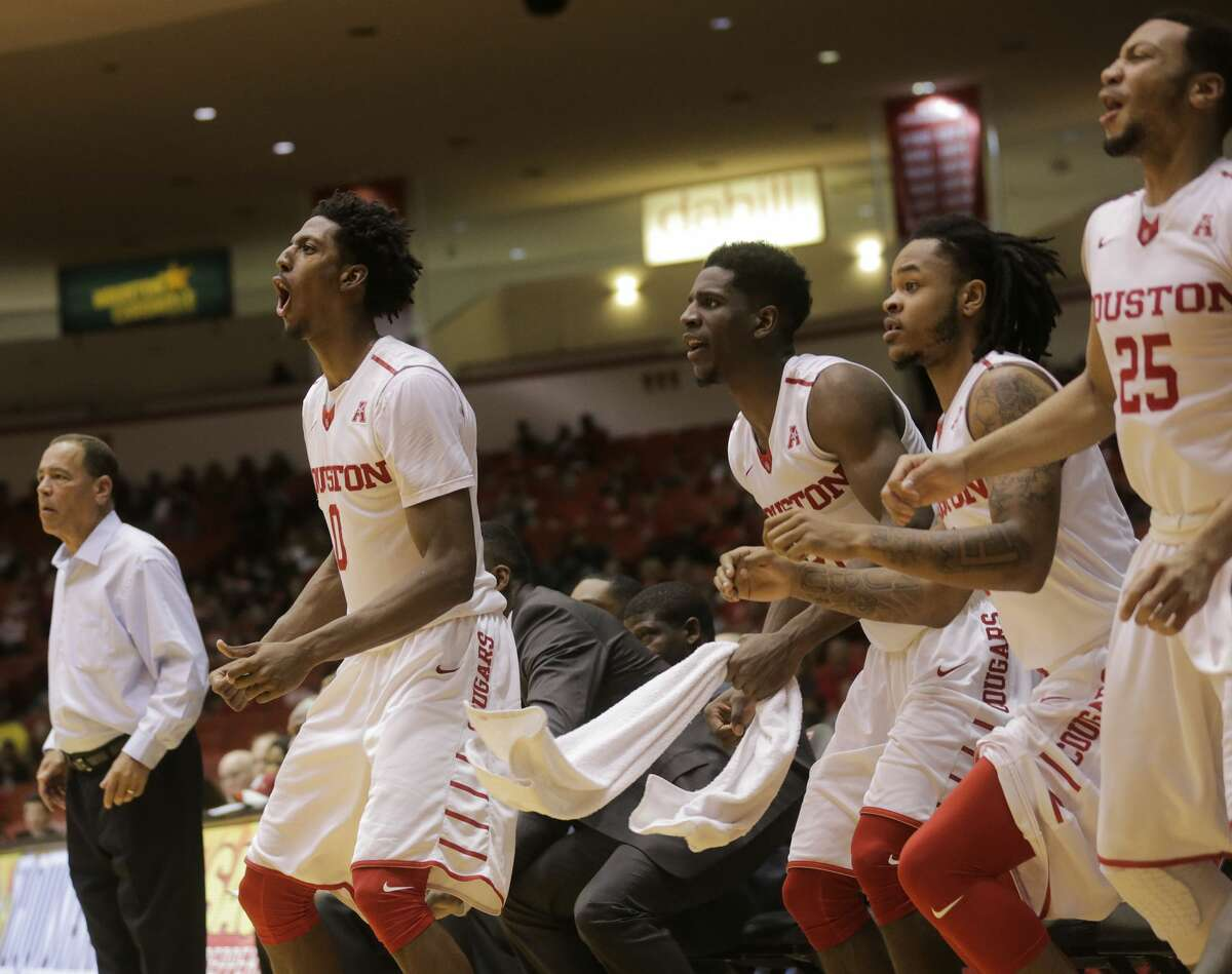 Houston Cougars bench reacts to a three-point shot in the second half against East Carolina Pirates on Sunday, March 5, 2017, in Houston. Houston won the game 73-51.( Elizabeth Conley / Houston Chronicle )