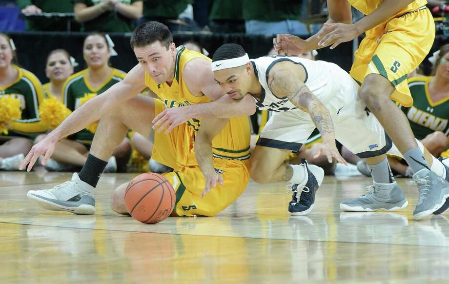 Brett Bisping of Siena, left, and Justin Robinson of Monmouth battle for a loose ball during their semifinal MAAC Basketball Tournament game at the Times Union Center on Sunday, March 5, 2017, in Albany, N.Y.   (Paul Buckowski / Times Union) Photo: PAUL BUCKOWSKI / 20039806A