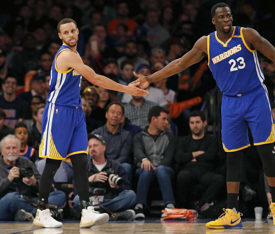 Golden State Warriors guard Stephen Curry (30) and Warriors forward Draymond Green (23) slap hands in the second half of an NBA basketball game against the New York Knicks at Madison Square Garden in New York, Sunday, March 5, 2017. The Warriors defeated the Knicks 112-105. (AP Photo/Kathy Willens) Photo: Kathy Willens, Associated Press