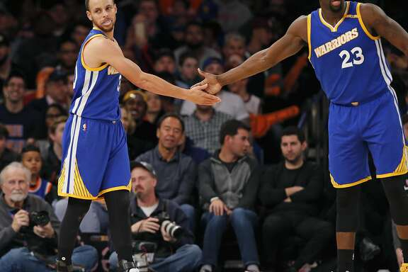 Golden State Warriors guard Stephen Curry (30) and Warriors forward Draymond Green (23) slap hands in the second half of an NBA basketball game against the New York Knicks at Madison Square Garden in New York, Sunday, March 5, 2017. The Warriors defeated the Knicks 112-105. (AP Photo/Kathy Willens)