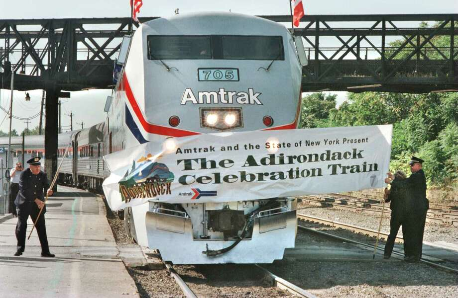 Times Union photo by  LUANNE M. FERRIS -- RENSSELAER, FRIDAY, SEPT. 20, 1996. AMTRAK CELEBRATES THE RETURN OF THE 'ADIRONDACK' TODAY. THE TRAIN WILL FOLLOW THE NORTHBOUND ROUTE OF THE SERVICE FROM NEW YORK CITY TO MONTREAL.  HERE THE TRAIN IS REINTRODUCED TO THE PUBLIC AS IT BREAKS THE BANNER ON THE TRACKS AT THE RENSSLEAR STATION.  09/21/96 Photo: LUANNE M. FERRIS / ALBANY TIMES UNION
