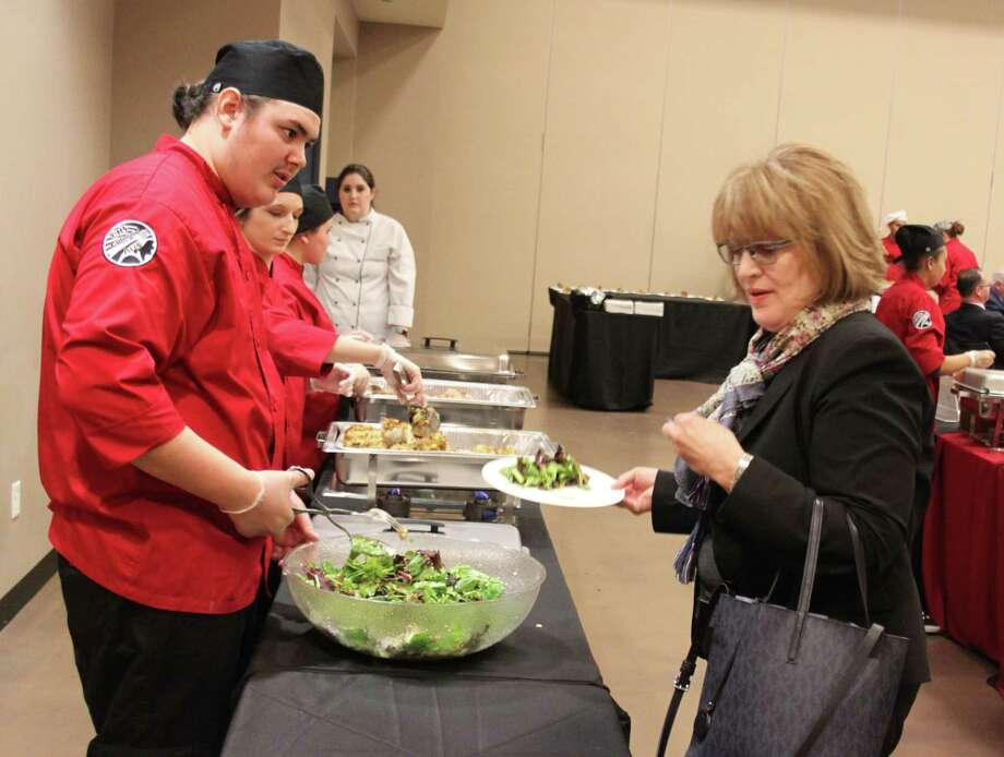 Students in the Cleveland High School Culinary Arts program serve lunch to members of the Greater Cleveland Chamber of Commerce during their March 2 luncheon. Photo: Jacob McAdams