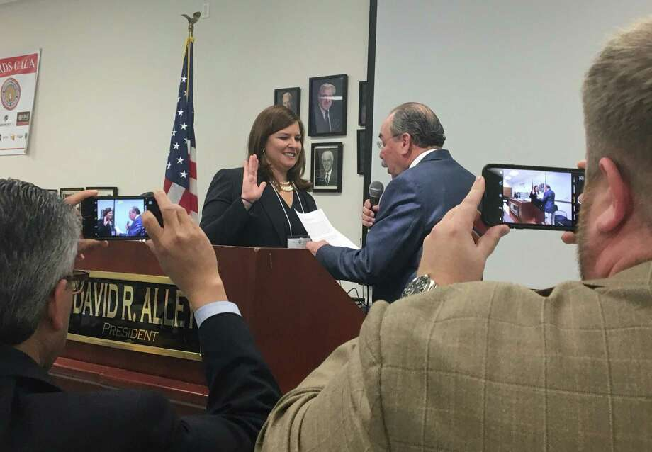 Lillie Schechter is sworn in as Harris County's Democratic Party chair after a vote by precinct leaders, Sunday, March 5, 2017. Schechter won a majority of the votes with 190 counted. Six candidates ran on Sunday. (Lindsay Ellis / Houston Chronicle) Photo: Lindsay Ellis / Houston Chronicle / 2017 Lindsay Ellis / Houston Chronicle