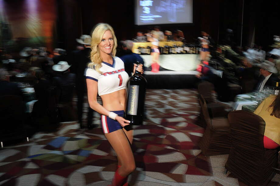 Houston Texan Cheerleader Lauren shows off the Texas Best Wine, a 2014 Pedernales Texas High Plains Tempranillo, at the Rodeo Uncorked Auction & Dinner at NRG Center Sunday March 05,2017. (Dave Rossman Photo) Photo: Dave Rossman, For The Chronicle / Dave Rossman