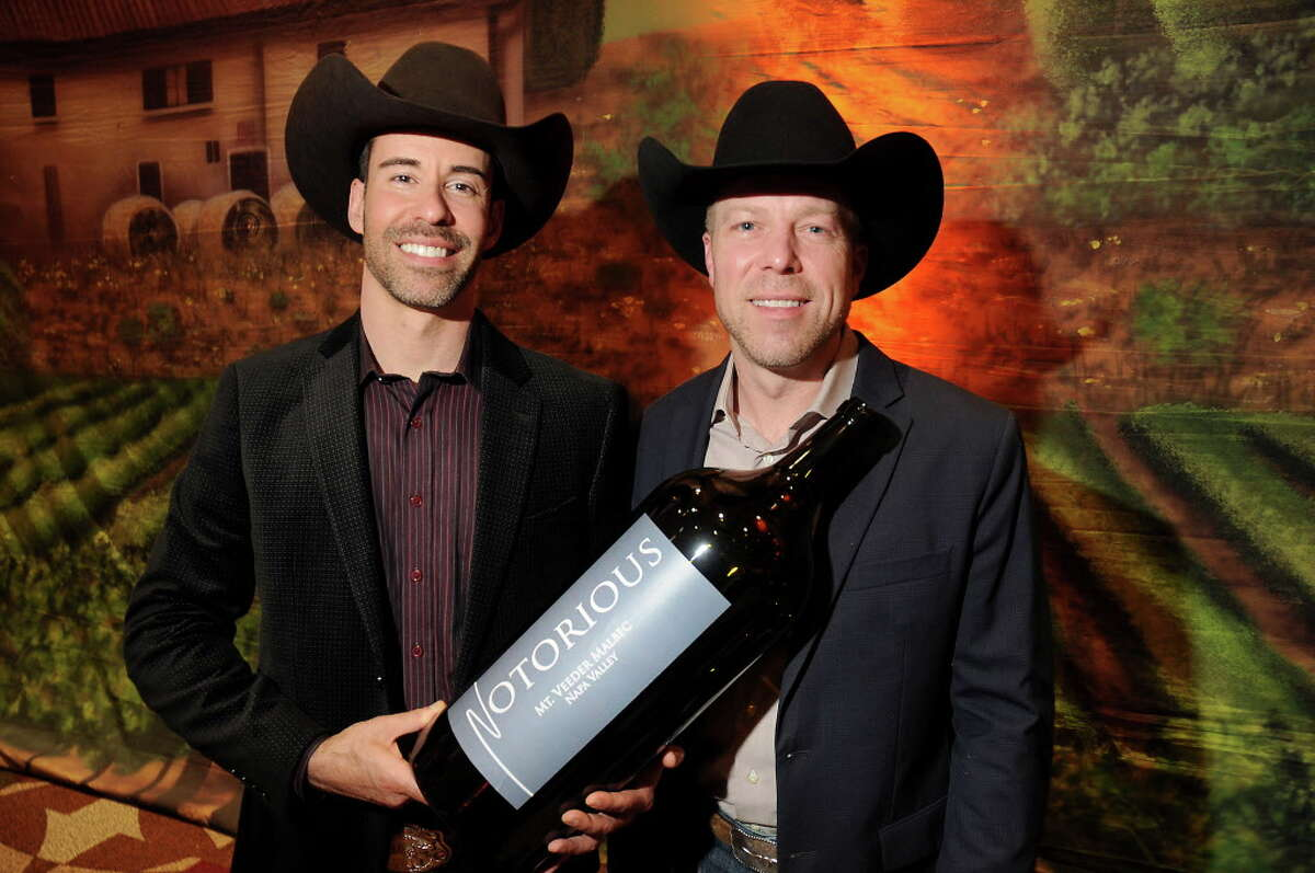 Ryan Levy and Ian Eastveld of The Nice Winery with their Reserve Champion/Best of Show 2013 Notorious Mt. Veeder Malbec at the Rodeo Uncorked Auction & Dinner at NRG Center Sunday March 05,2017. (Dave Rossman Photo)