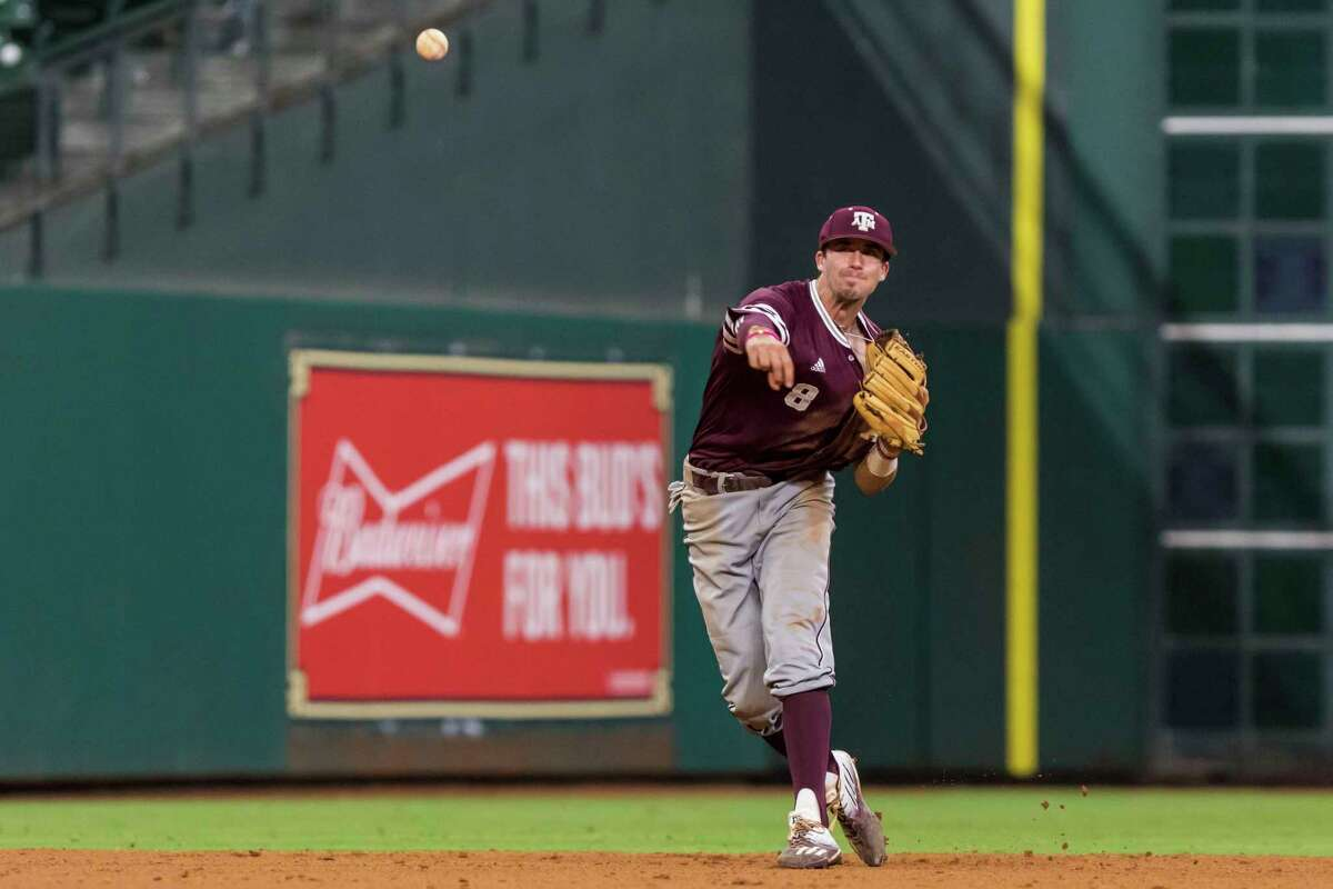 Texas A&M shortstop Braden Shewmake (8) throws out a Baylor baserunner during a NCAA baseball game at Minute Maid Park on Sunday, Mar. 5, 2017, in Houston.