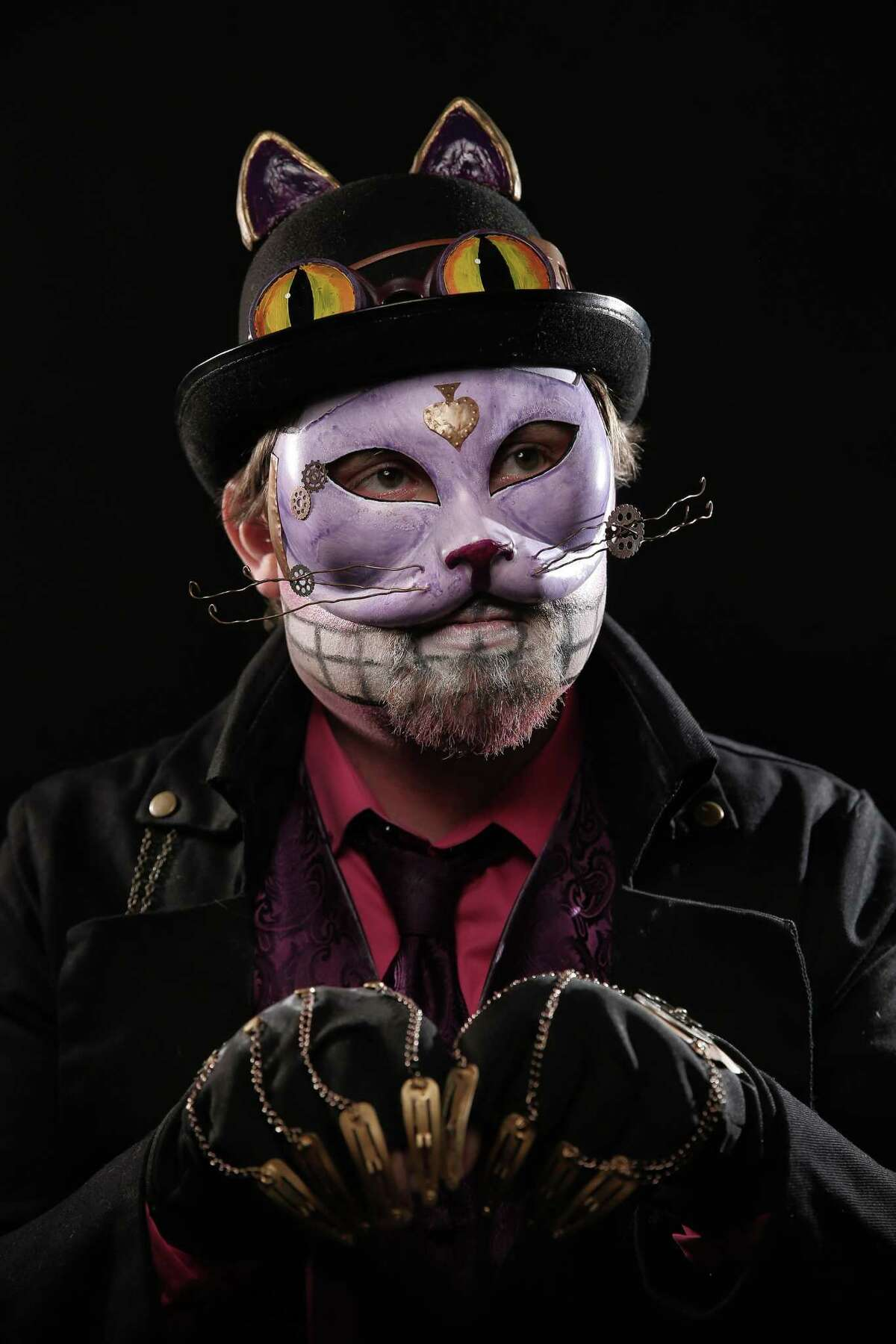 The Cheshire Cat, portrayed by Aaron Murphy, poses for a portrait at Emerald City Comicon at the Washington State Convention Center on Sunday, March 5, 2017