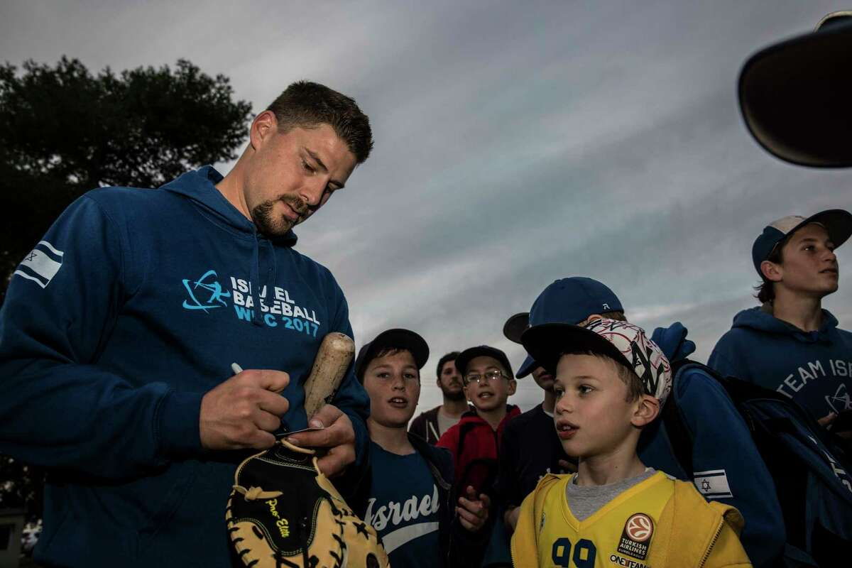 Ryan Lavarnway, who caught in the majors for five seasons, signs autographs during his Israel visit.