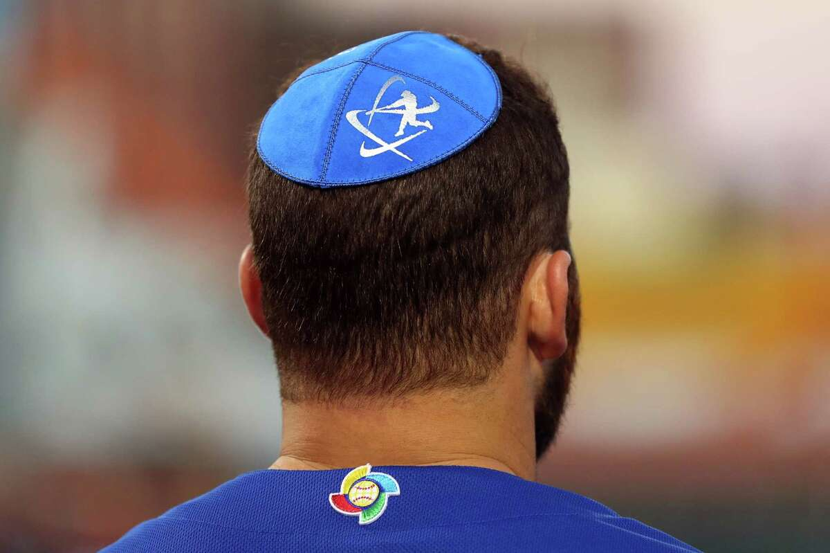 NEW YORK, NY - SEPTEMBER 22: Members of Team Israel wear Nike Swingman yamakas during the pre-game ceremonies prior to Game 2 of the 2016 World Baseball Classic Qualifier at MCU Park on Thursday, September 22, 2016 in the Brooklyn borough of New York City. (Photo by Alex Trautwig/MLB Photos via Getty Images)