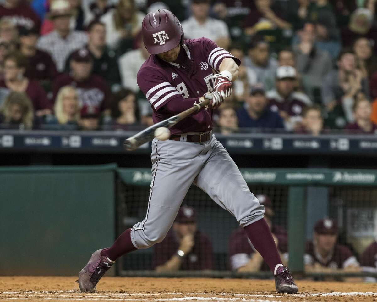 Texas A&M third baseman Walker Pennington (9) reaches base with single during a NCAA baseball game at Minute Maid Park on Sunday, Mar. 5, 2017, in Houston. (Joe Buvid / For the Houston Chronicle)