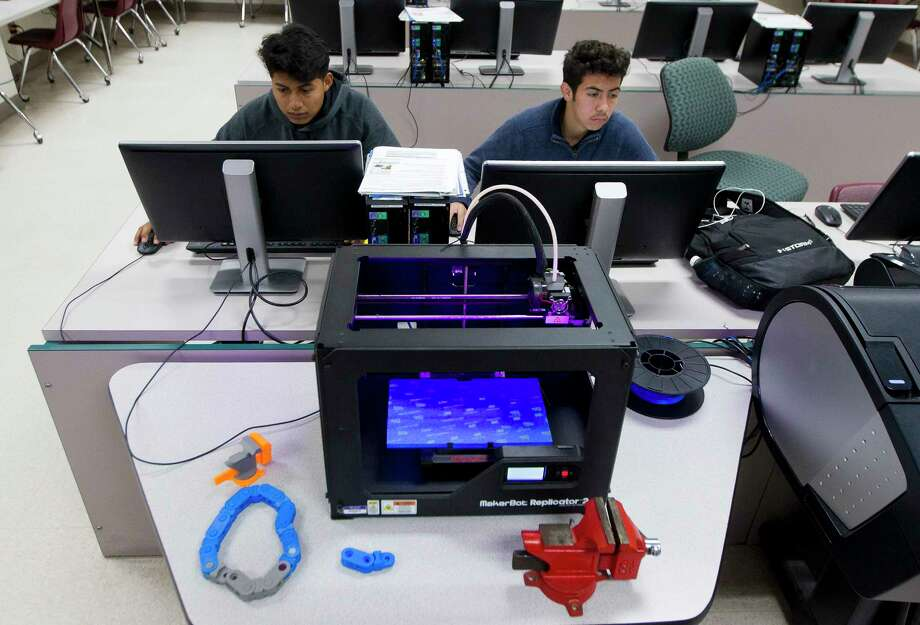 Willis High School seniors Marco Gonzalez, 17, and Gabriel Ramirez, 18, work on engineering projects Wednesday in Willis. Gonzalez and Ramirez are preparing to take their engineering certification test as part of the district's engineering class. Willis ISD plans to open a $39.4 million Career and Technology Education building as part of the $109.5 million bond passed in November 2015. Photo: Jason Fochtman, Staff Photographer / © 2017 Houston Chronicle