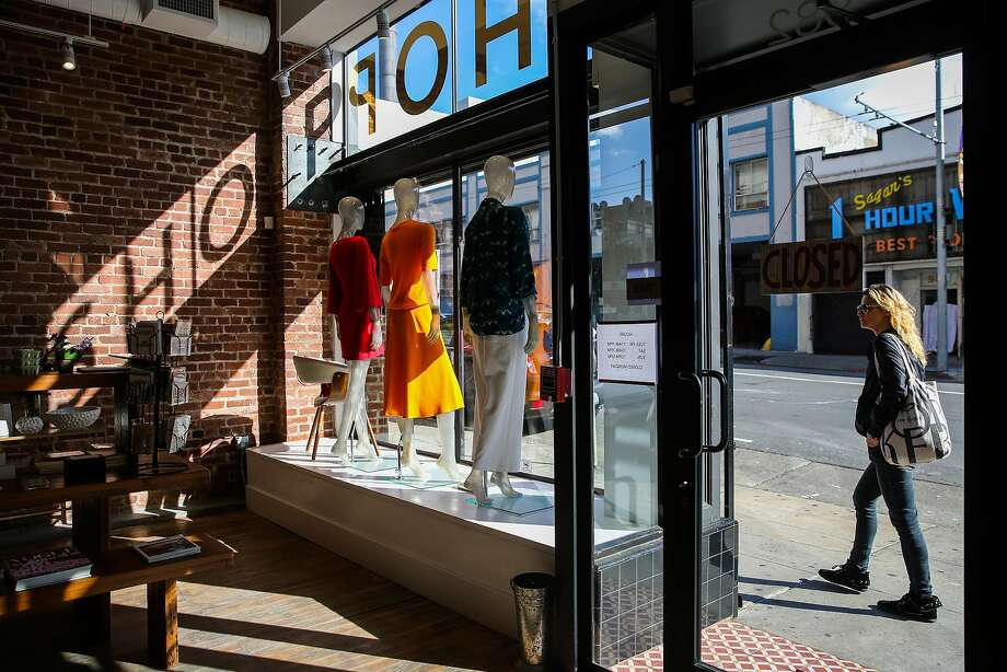 A woman walks by the fashion boutique Hero Shop on Post Street. Photo: Gabrielle Lurie, The Chronicle