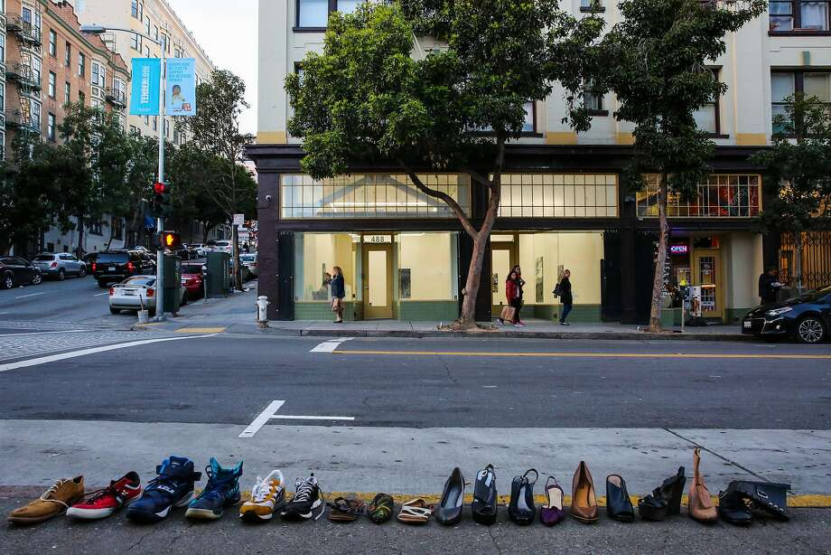 Shoes are lined up on the sidewalk for sale across the street from Jessica Silverman gallery on Ellis Street. Photo: Gabrielle Lurie, The Chronicle