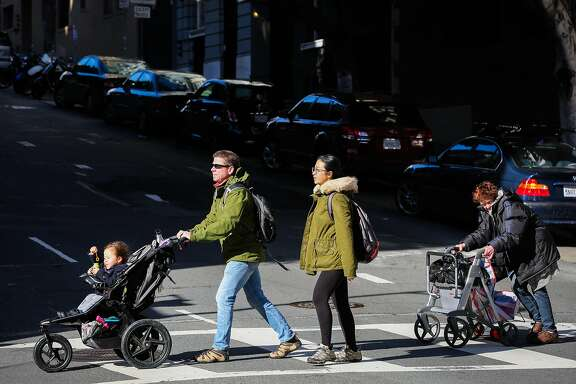 Pedestrians cross Leavenworth Street in San Francisco, California, on Sunday, March 5, 2017.