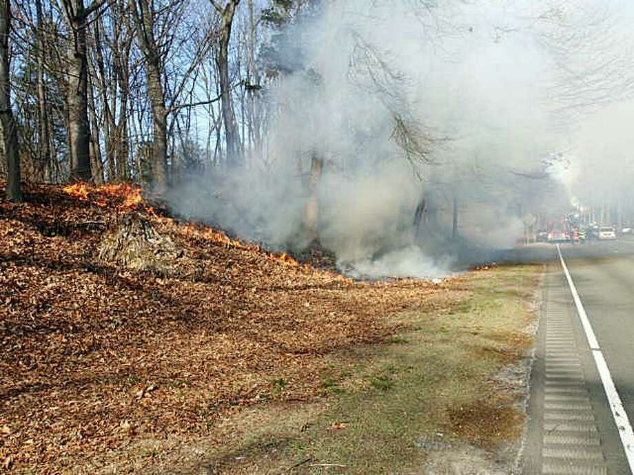 One of the first brush fires of the season happened on Saturday, March 4, 2017 when a section of woods off the Merritt Parkway caught fire near the Norwalk/Westport town line. Both Norwalk and Westport firefighters responded to the fire that was located near southbound Exits 41 and 40. When they arrived they found an appoximate 300 x 10-foot area burning in the area of the West Rocks overpass. The fire marked the start of the spring forest fire season in Connecticut. Photo: Westport Fire Department Photo