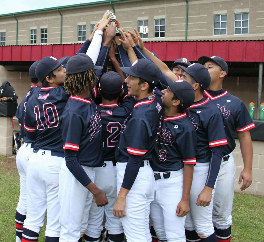The Aldine-Davis Falcons raise their first place trophy in the air after defeating the New Waverly Bulldogs in their final game of the Cleveland Rotary Tournament. Photo: Jacob McAdams