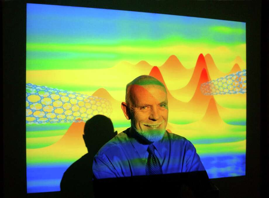 Rice University professor Richard Smalley, who leads a group researching the frontiers of nanoscience and nanotechnology.  photographed Friday morning, January 31, 2003, with projections of nanotubes. (Smiley N. Pool/Chronicle) Photo: SMILEY N. POOL, Staff / Houston Chronicle
