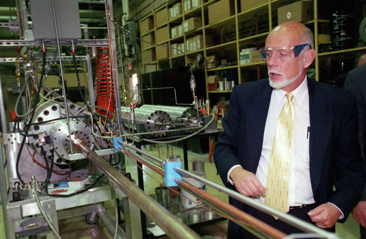 HOUCHRON CAPTION (09/28/2001): Richard Smalley, co-founder of Carbon Nanotechnology and a professor at Rice University, shows off some of the equipment used to manufacture nanotubes, submicroscopic materials used to develop cutting-edge devices and materials.