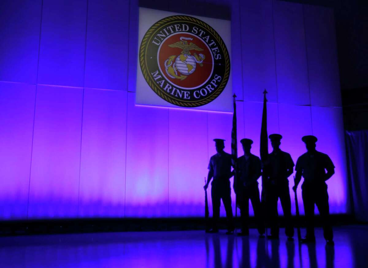 A U.S. Marine Corps Color Guard stands under a Marine Corps emblem in Jupiter, Fla., in 2014 The Defense Department is investigating reports that some Marines shared naked photographs of female Marines, veterans and other women on a secret Facebook page, some of which were taken without their knowledge.