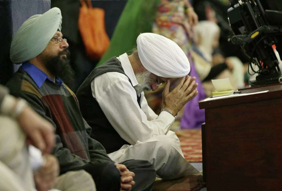 "A man bows his head as he attends Sunday services at the Gurudwara Singh Sabha of Washington, a Sikh temple in Renton, Washington on Sunday in south of Seattle. Authorities said a Sikh man reported that a gunman shot him in his arm Friday as he worked on his car in his driveway and told him ""go back to your own country."" Photo: Ted S. Warren /AP / Copyright 2017 The Associated Press. All rights reserved."