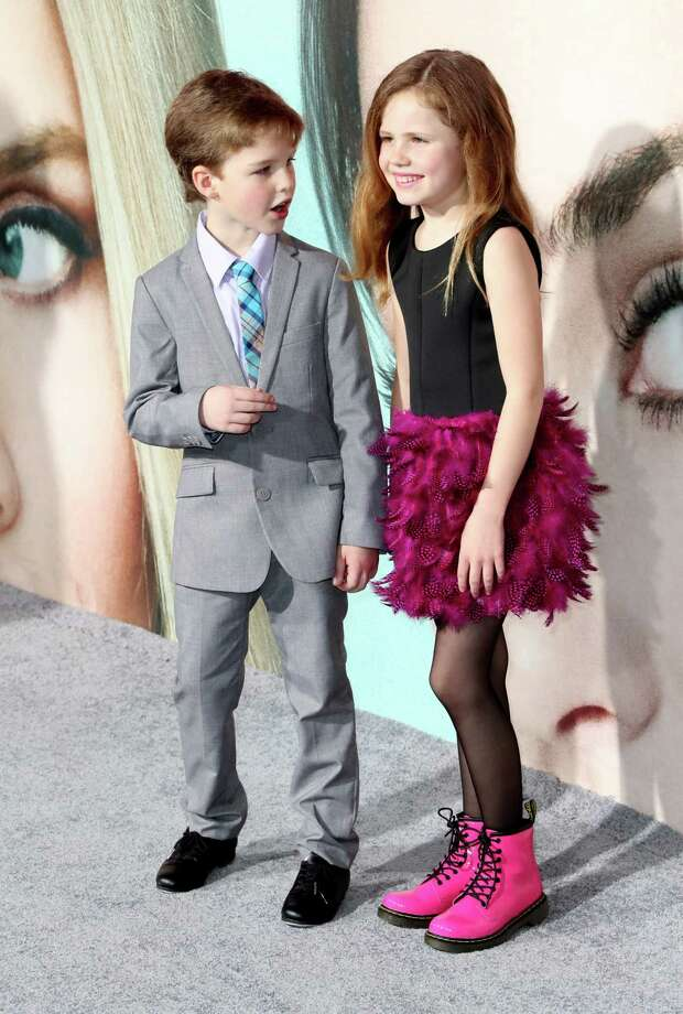 "Iain Armitage, left, has reportedly been picked to play the young Sheldon Cooper in a proposed spinoff of ""The Big Bang Theory."" The 8-year-old actor is shown here attending the premiere of HBO's ""Big Little Lies,"" in which he also has a role, Feb. 7, 2017, in Hollywood, Calif. Photo: Frederick M. Brown, Getty Images / 2017 Getty Images"