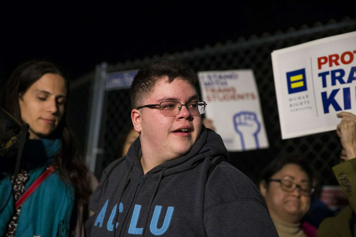 FILE-- Gavin Grimm, a transgender boy whose suit against the Gloucester County School Board is going before the Supreme Court, is cheered on during a protest outside the White House in Washington, Feb. 22, 2017. The Supreme Court announced March 6 that it would not hear Grimm's case on transgender rights after all, acting after the Trump administration changed the federal government's position on whether public schools had to allow transgender youths to use bathrooms that matched their gender identities. (Al Drago/The New York Times)
