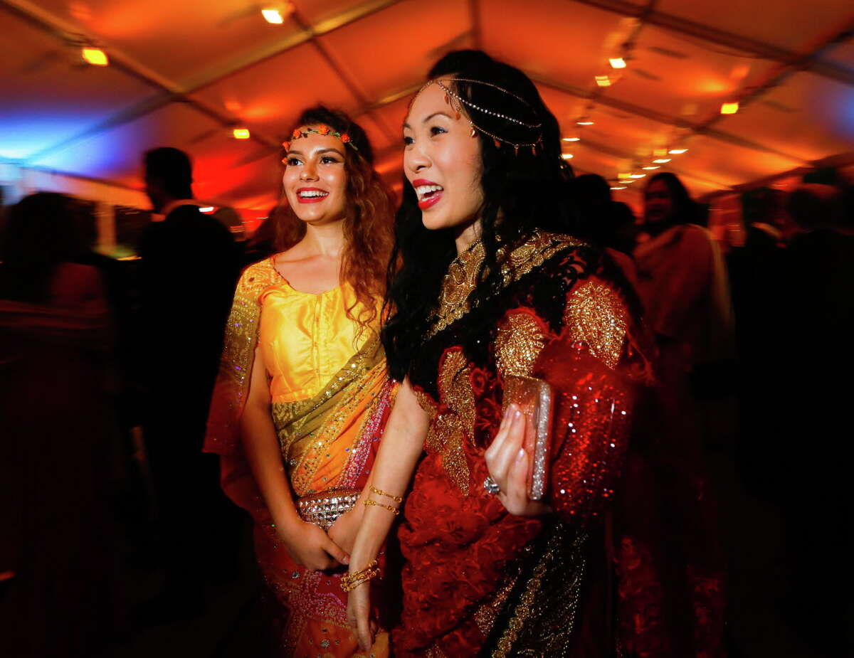 Connie Kwan-Wong greets another attendee at the Asia Society's Tiger Ball on Friday, March 3, 2017, in Houston. (Annie Mulligan / Freelance)