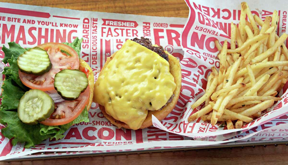Classic smash burger with smash fries are seen at a Smashburger on in Colonie, NY. The fast food chain is offering a pass where customers can purchase daily burgers or entree items for $1 for 54 days straight.