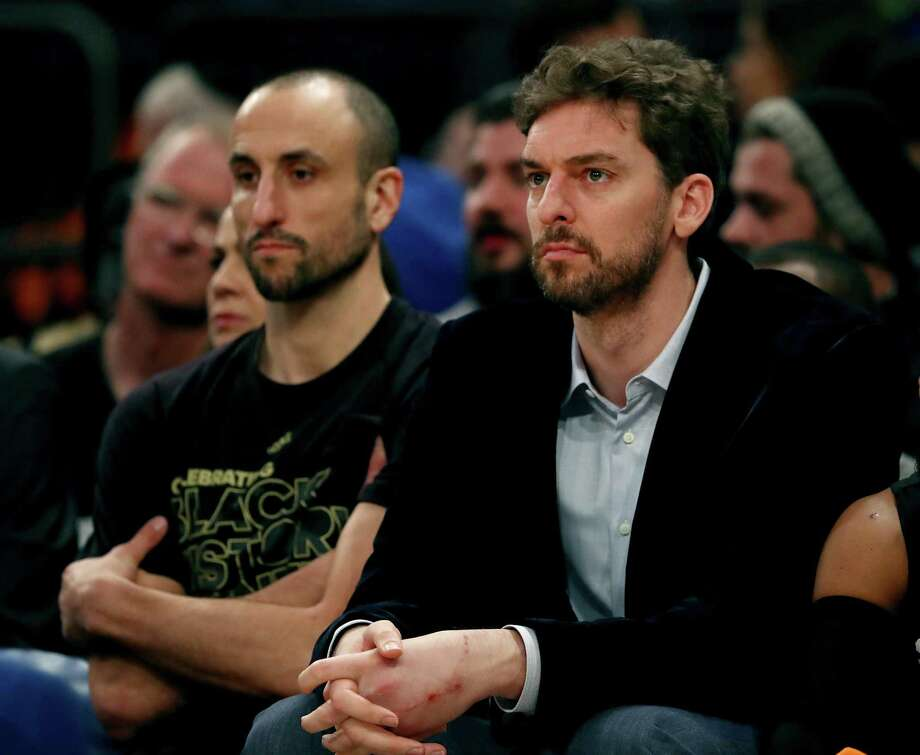 Pau Gasol (right) and Manu Ginobili of the Spurs sit on the bench in the first half against the Knicks at Madison Square Garden on Feb. 12, 2017 in New York. Photo: Elsa /Getty Images / 2017 Getty Images