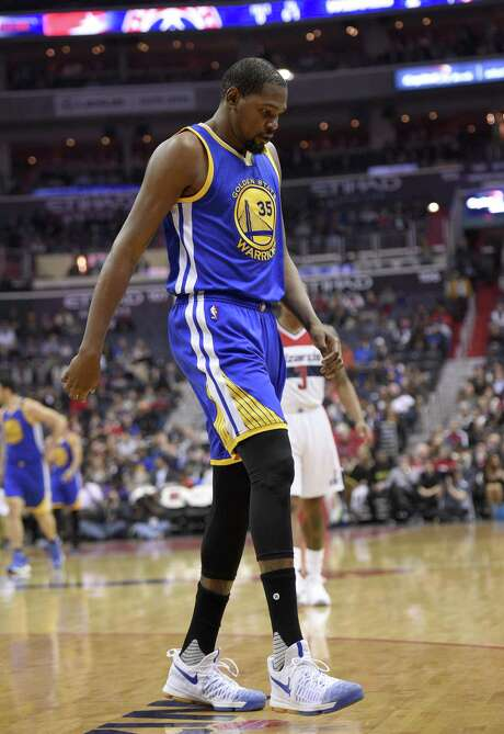 Kevin Durant  walks to the bench after hyperextending his left knee Feb. 28 at Washington. Photo: Nick Wass / Associated Press / FR67404 AP