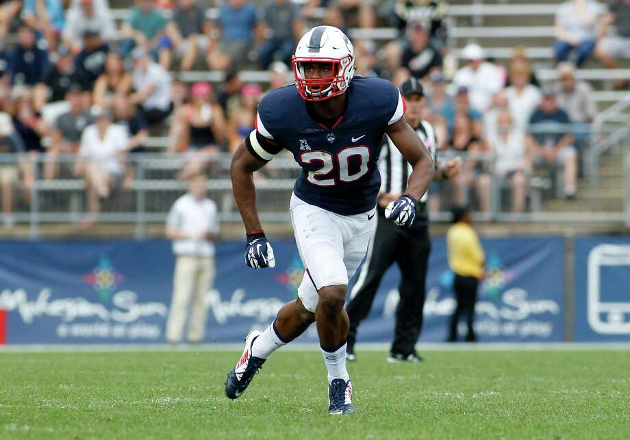 File - In this Sept. 12, 2015, file photo, Connecticut safety Obi Melifonwu (20) follows the play during the third quarter of an NCAA college football game against Army, in East Hartford, Conn. UConn, one of several programs being mentioned as a candidate for expansion by the Big 12, is dealing with something new in head coach Bob Diaco's third season as its head football coach _ expectations. The defense, which gave up just 19.5 points per game, is expected to be the team's strength, led by safety Obi Melifonwu, touted by Diaco as the best at his position in the nation. (AP Photo/Stew Milne, FIle) Photo: Stew Milne, Associated Press / FR56276 AP