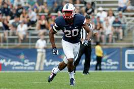 File - In this Sept. 12, 2015, file photo, Connecticut safety Obi Melifonwu (20) follows the play during the third quarter of an NCAA college football game against Army, in East Hartford, Conn. UConn, one of several programs being mentioned as a candidate for expansion by the Big 12, is dealing with something new in head coach Bob Diaco's third season as its head football coach _ expectations. The defense, which gave up just 19.5 points per game, is expected to be the team's strength, led by safety Obi Melifonwu, touted by Diaco as the best at his position in the nation. (AP Photo/Stew Milne, FIle)