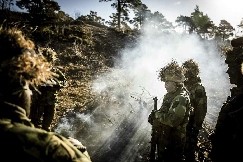 Swedish soldiers in a logistics company hold a training exercise in Gotland, Sweden, Feb. 24, 2017. On March 2, the Swedish government announced that mandatory military service — abolished in 2010 — would be introduced starting next year, Four thousand men and women will be drafted into the defense forces. (Gordon Welters/The New York Times) Photo: GORDON WELTERS, STR / NYT / NYTNS