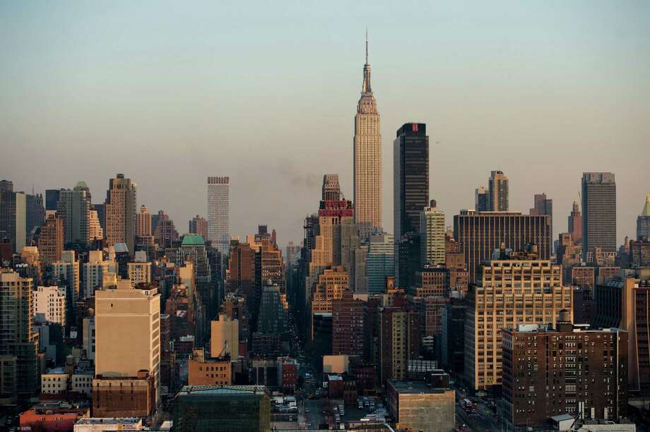 Contracts for high-end Manhattan properties fell 18 percent last year, according to luxury brokerage Olshan Realty Inc. The trend has been reversing since January. But those properties tended to sell at a discount after lingering on the market. Shown is the Manhattan skyline. Photo: Bloomberg News /File Photo / © 2013 Bloomberg Finance LP