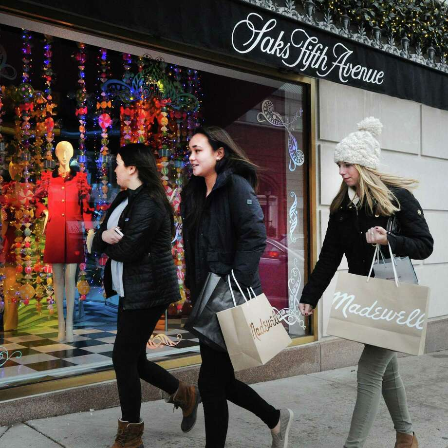 Shoppers on Greenwich Ave. in Greenwich, Conn., during the 2016 holliday season. After a January lull, consumer spending jumped in February, particularly in higher-income households according to a monthly Gallup survey. Photo: Bob Luckey Jr. / Hearst Connecticut Media / Greenwich Time