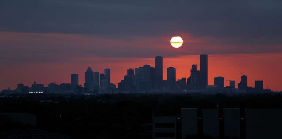 The sun sets behind the Houston skyline viewed from the east side of town over the ship channel from 610, Wednesday, May 11, 2016, in Houston. ( Mark Mulligan / Houston Chronicle ) sunset, downtown, Houston, skyline, silhouette Photo: Mark Mulligan, Staff / © 2016 Houston Chronicle