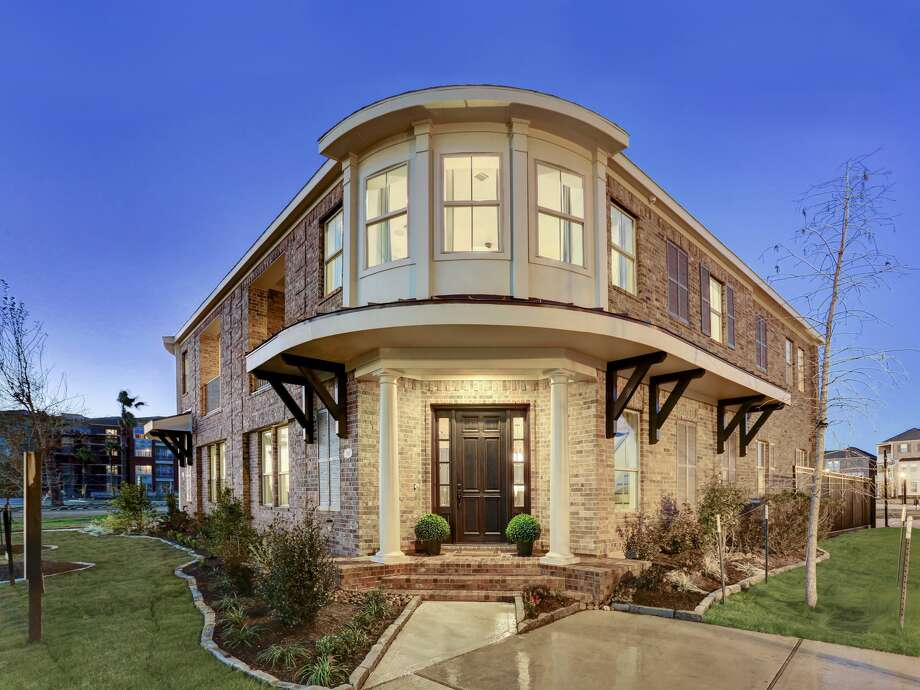 Gracepoint homes opens sugar land brownstone model for Two story model homes