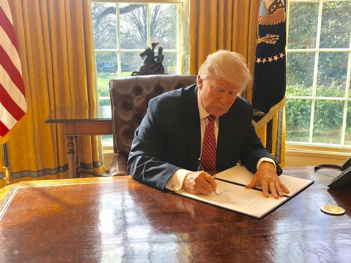President Donald Trump on Monday signs a new version of his controversial travel ban, aiming to withstand court challenges while still barring new visas for citizens from six Muslim-majority countries and shutting down the U.S. refugee program.