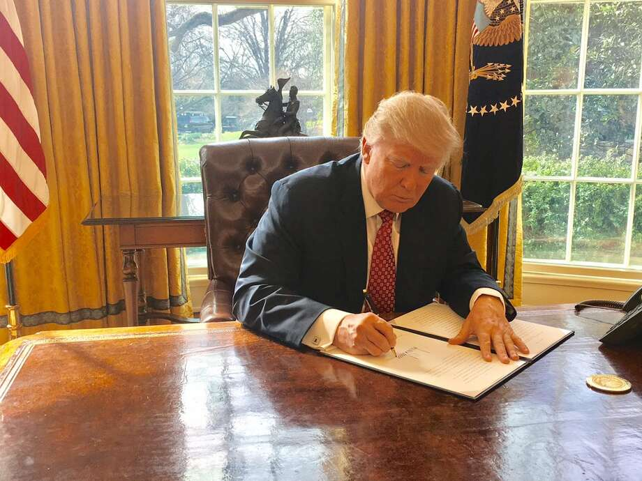 President Donald Trump on Monday signs a new version of his controversial travel ban, aiming to withstand court challenges while still barring new visas for citizens from six Muslim-majority countries and shutting down the U.S. refugee program. Photo: White House