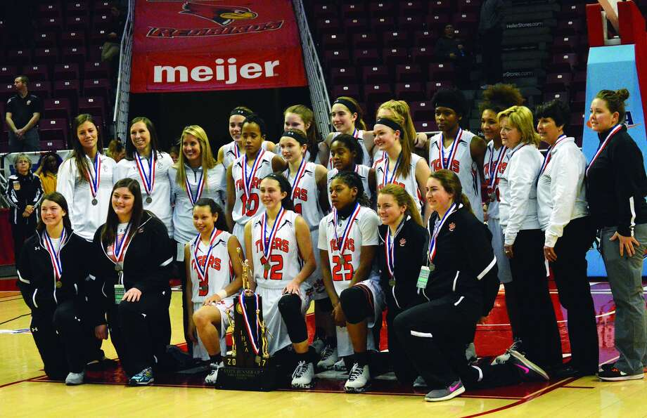 The Edwardsville Tiger girls' basketball team poses with its Illinois Class 4A second-place trophy following Saturday's championship game at Redbird Arena in Normal. Photo: Matt Kamp • Intelligencer