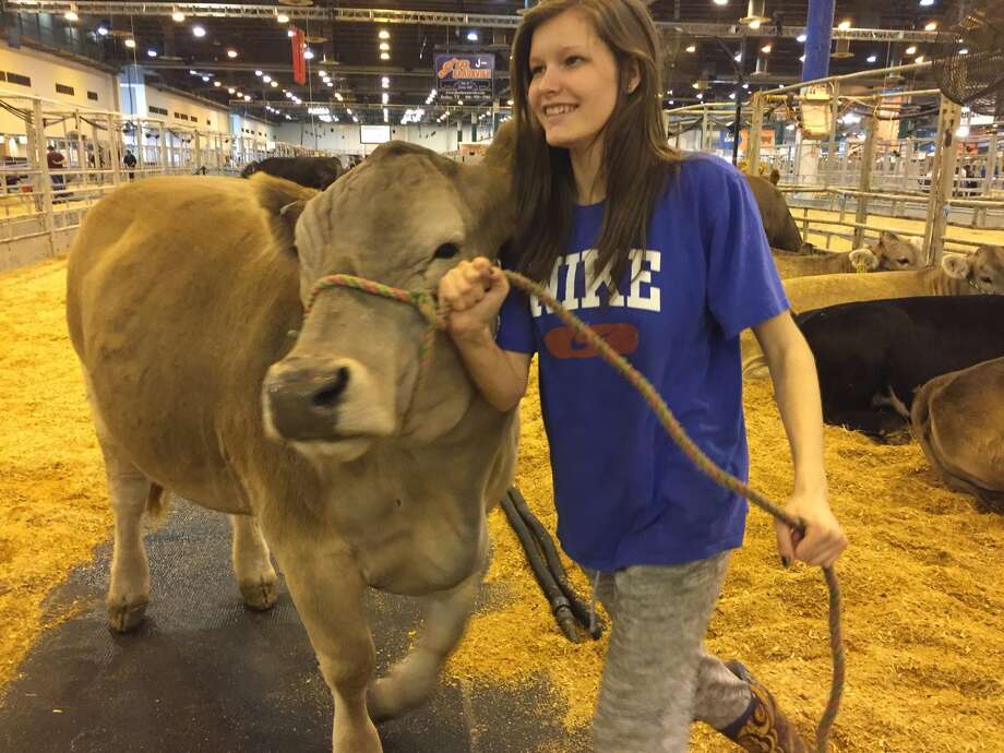 Makinzie Hinton, 16, takes care of three of her own cows in the Texas panhandle.