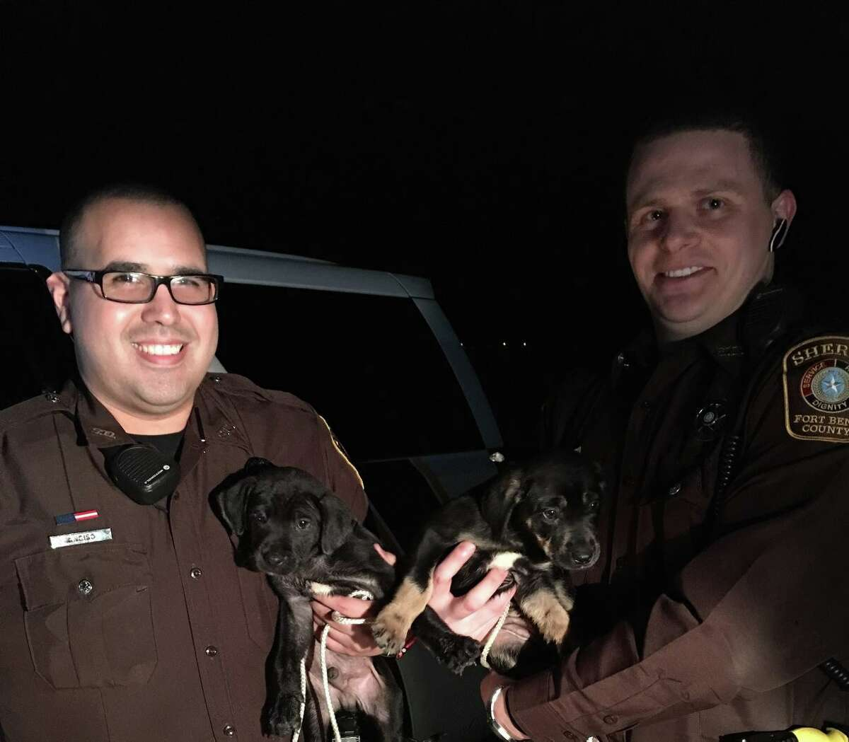 Fort Bend County deputies D. Lytton and M. Anciso are doing their part to make Monday better by adopting tiny puppies from the side of the road.