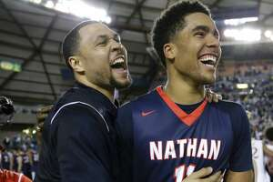 Nathan Hale head coach Brandon Roy, left, celebrates with center Jontay Porter (11) after Nathan Hale defeated Garfield in the Washington state boys' 3A high school basketball championship, Saturday, March 4, 2017, in Tacoma, Wash. (AP Photo/Ted S. Warren)