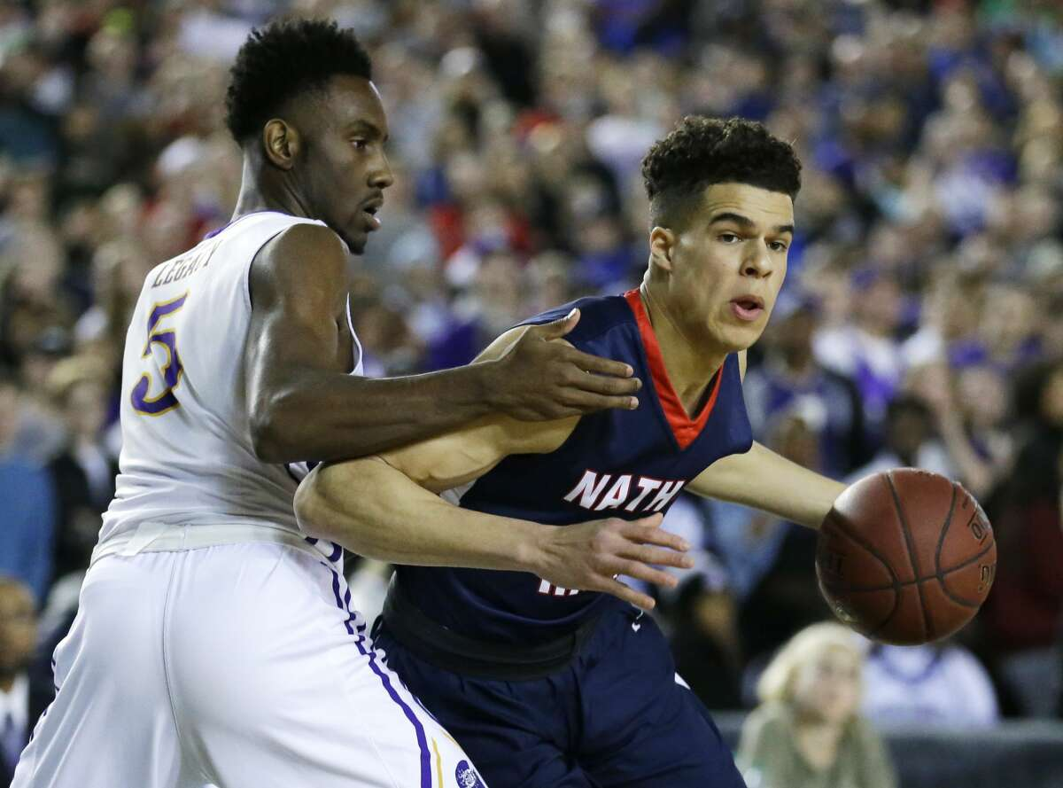 Nathan Hale forward Michael Porter Jr., right, drives around Garfield guard Jaylen Nowell during the first half of the Washington state boys' 3A high school basketball championship, Saturday, March 4, 2017, in Tacoma, Wash. (AP Photo/Ted S. Warren)