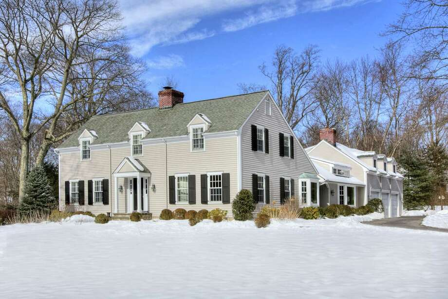 The 4,764-square-foot cream-colored colonial house at 452 Hoyt Farm Road sits on a corner lot of two level acres. It has five bedrooms and it is convenient to the Merritt Parkway, downtown New Canaan and the train station.