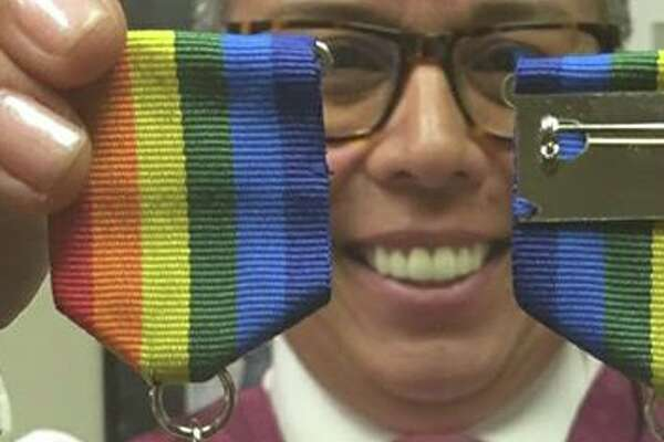 "San Antonio attorney Rosie Gonzalez and her ""El Pendejo,"" President Donald Trump-inspired medal."