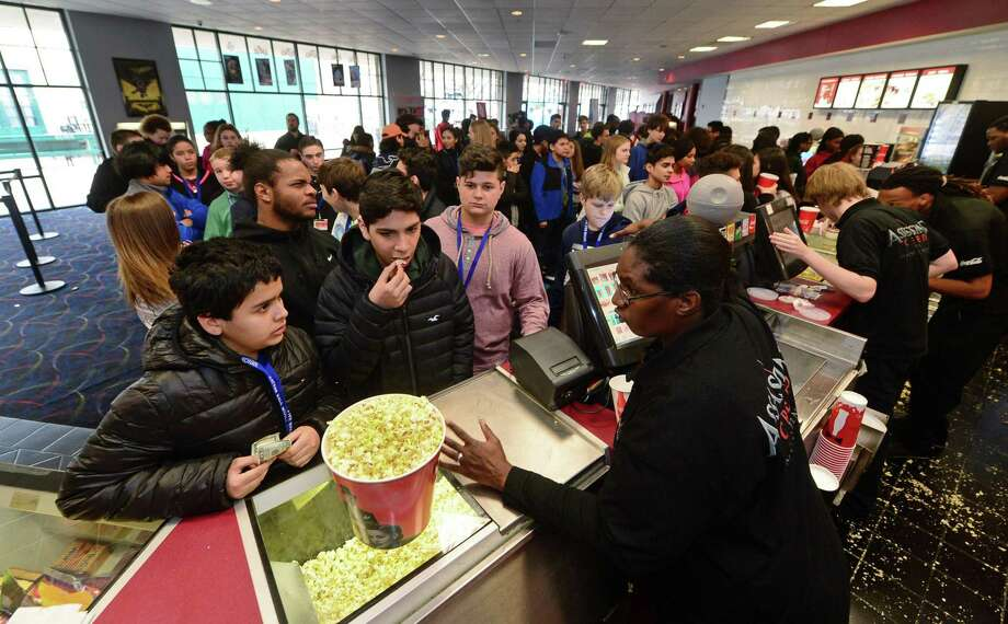 Nathan Hale Middle School students throng the lobby of the Bow Tie Regent theater in South Norwalk, Conn., during a Jan. 27, 2017 field trip. Ridgefield-based Bow Tie Cinemas is undertaking a multimillion-dollar upgrade of Bow Tie Regent, to include new seating. Photo: Erik Trautmann / Hearst Connecticut Media / Norwalk Hour